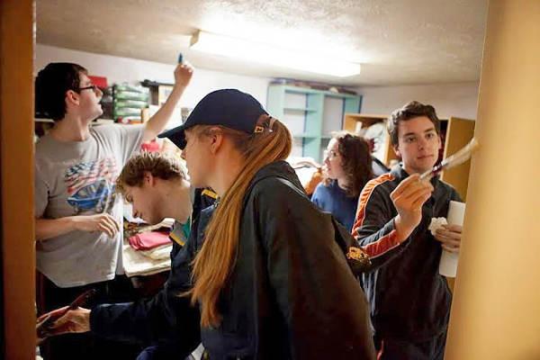 Student volunteers painting
